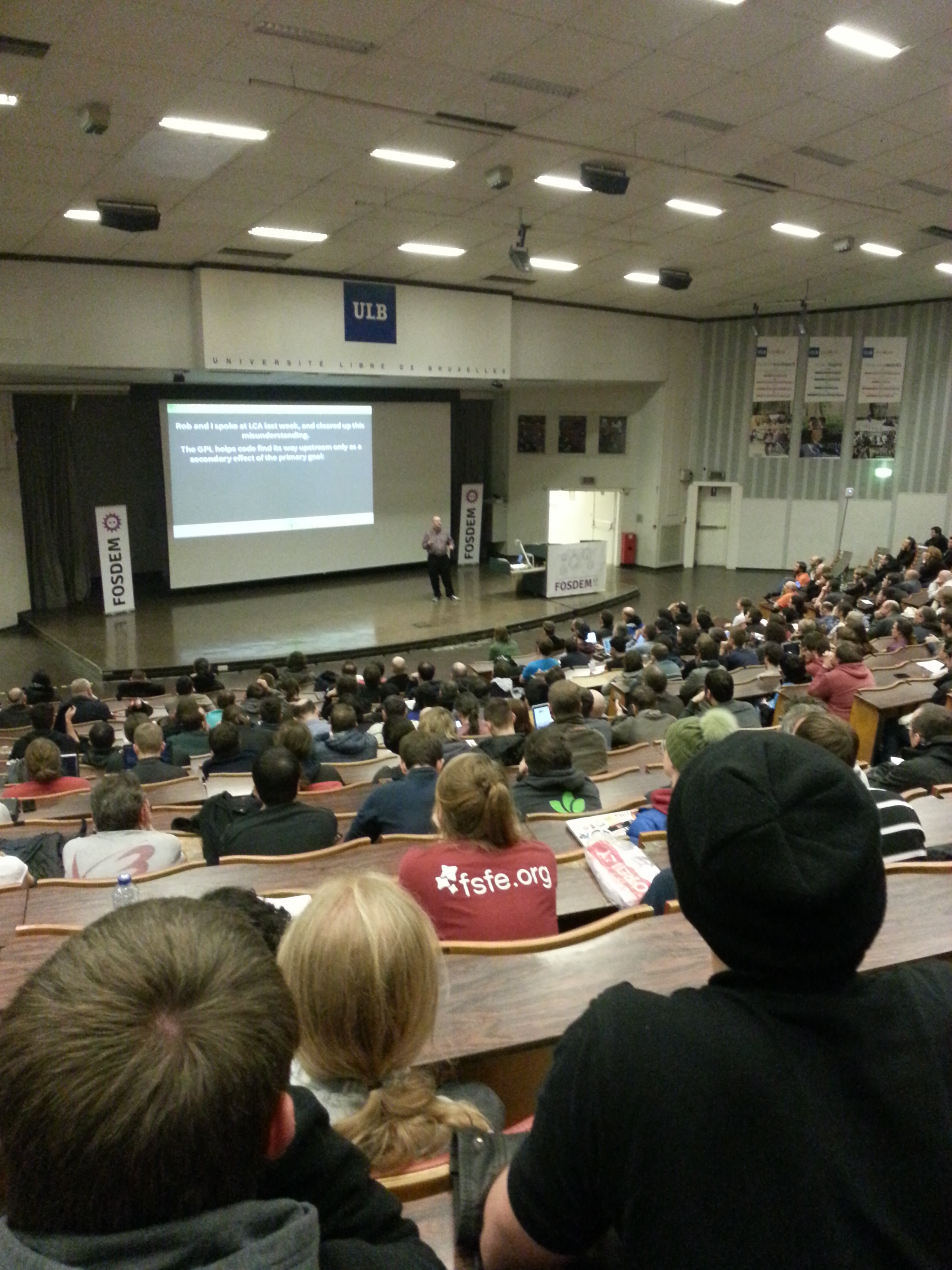 Photo of Bradley Kuhn delivering his keynote at FOSDEM