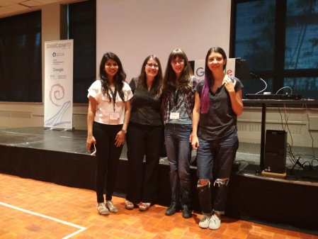 Photo of Karen with Outreachy alums at DebConf
