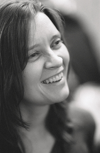 Black and white picture of Allison Randal smiling in profile
