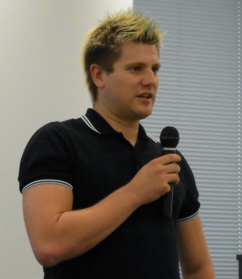 Photo of Christoph Hellwig speaking at DebConf 2015